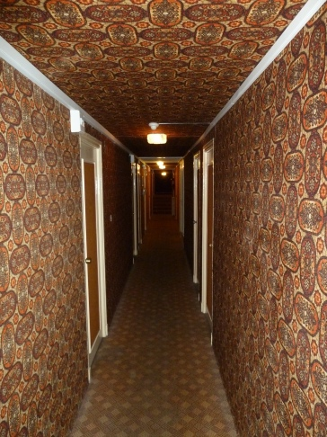 Carpeted walls, ceiling, and floor of the hotel at the Perpignan train station hotel.