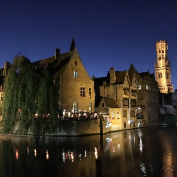 Most photographed spot in Bruges: the canals, restaurants, and the Belfort light up in a perfect dusk sky.